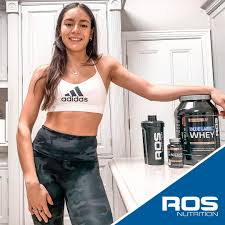 Kate Doherty poses with ROS Nutrition product